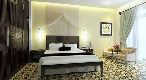 Không gian phòng ngủ hài hòa giữa các gam màu sáng tối với họa tiết hoa văn sàn làm tôn thêm nét đẹp Đông Dương đặc trưng. Hệ đèn chiếu sáng tinh tế tạo cảm giác ấm cúng và bật lên không gian đậm chất hoài cổ.. Ảnh:Không Gian Hoàn Hảo.