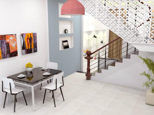 Những mảng tường khác màu làm điểm nhấn cho phòng ăn thêm sinh động.