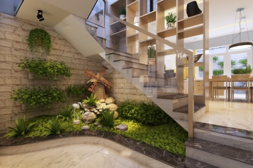 Tiểu cảnh xanh dưới chân cầu thang làm điểm nhấn cho không gian và làm mát không gian