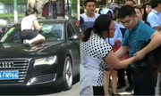 Vợ lao lên mui xe đập phá khi chứng kiến chồng chở bồ