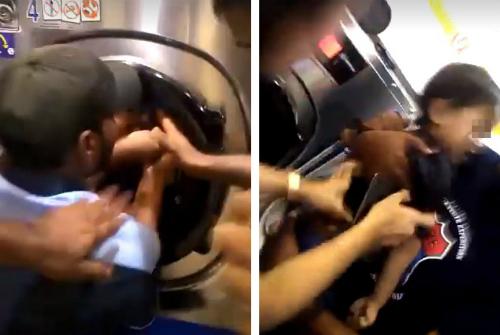 Giải cứu cậu bé khỏi máy giặt - Ảnh: Asia One