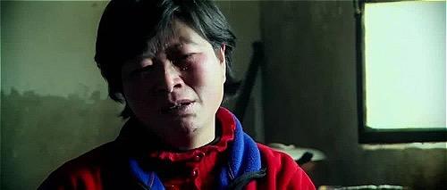 Nỗi đau mất con vẹn nguyên trong bà Lý, dù đứa trẻ đã rời khỏi mẹ 20 năm. Ảnh:Wenxuecity.