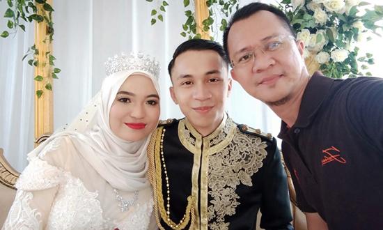 Cô dâu và chú rể (từ trái qua). Ảnh: Facebook Muhammad Rusydan Mat Yusof.