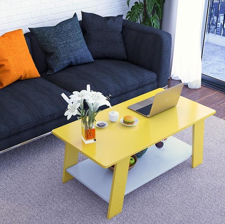 Bàn trà sofa hai tầng đa năng có kết cấu hình chữ nhật với 4 chân đế vững chắc. Sản phẩm lắp ráp dễ dàng tại nhà bằng đinh và ốc vít có sẵn. Bàn gồm hai tầng, thích hợp dùng cho không gian phòng khách nhỏ, căn hộ chung cư... Sản phẩm có 4 màu cho bạn thoải mái lựa chọn gồm: vàng, trắng, xám và màu cà phê. Bàn có giá ưu đãi 23% trên Shop VnExpress, giảm còn 605.000 đồng (giá gốc 790.000 đồng).