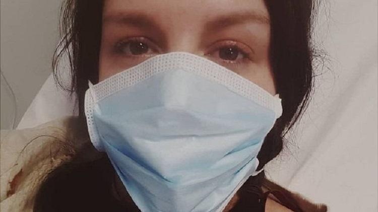 Jessie Clark phải nhập viện thở khó khăn, đau mỏi cơ thể. Ảnh: BBC.